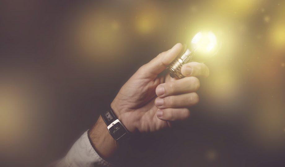 Man holding up an LED bulbs