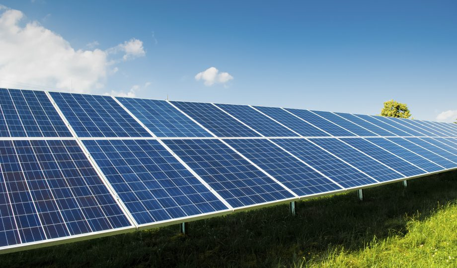 Solar power panels on green field